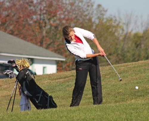 Huntington North senior Gabrielle Malone angles a shot toward the green on the sixth hole at Noble Hawk Golf Links, in Kendallville, during the girls' golf team's stop at the East Noble Regional on Saturday, Sept. 28.