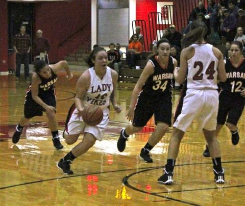 Huntington North's Maddie Klender (second from left) uses a pick from teammate Paige Coolman and takes the ball toward the basket in the Lady Vikings' season opener at HNHS on Saturday, Nov. 16.