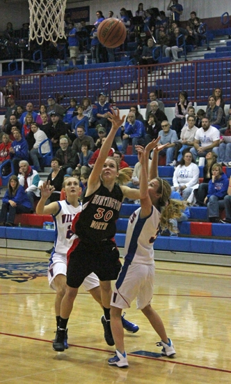 Huntington North's Hannah Stoffel launches a short shot past a host Whitko defender on Friday, Nov. 22, in the Lady Vikings' 57-51 loss.