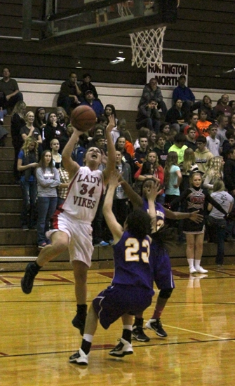 Lady Viking Madi Canady takes it strong to the hoop against visiting Marion on Friday night, Dec. 6. Canady scored 11 points in the 58-52 win for HNHS.