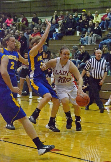 Huntington North guard Maddie Klender heads strong to the basket against visiting Homestead on Friday, Nov. 30. The Lady Vikings lost, 83-52.