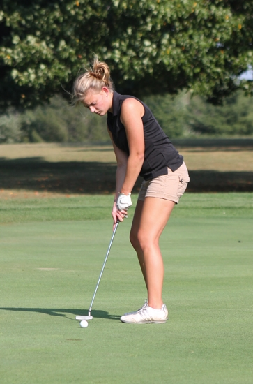 Huntington North golfer Gabrielle Malone putts on the ninth hole at LaFontaine Golf Club on Tuesday, Sept. 10, in a match against Manchester.