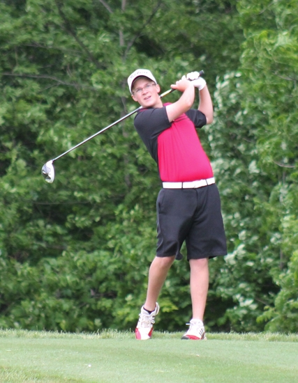 Huntington North's Zac Tackett follows through on his tee shot at the third hole at the Warsaw Boys' Golf Sectional on Friday, May 31, at Stonehenge Golf Course.