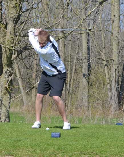 Huntington North golfer Zac Tackett gets ready to launch a tee shot on the 11th hole at Norwood Golf Course during the Huntington North Viking Invitational on Saturday, April 26.