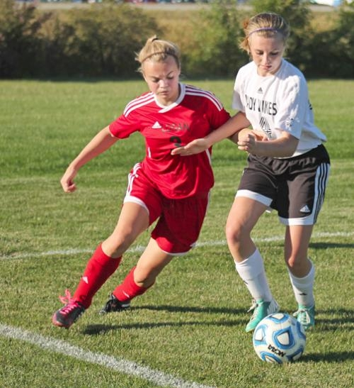 Huntington North's Courtney Christle (right) jostles with Logansport's Allie Clarke going for the ball during girls' soccer action at HNHS on Tuesday, Sept. 24