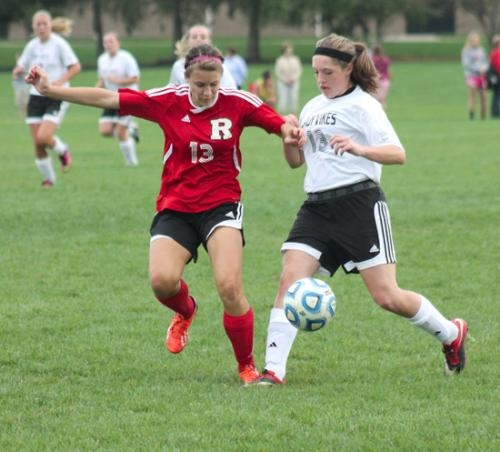 Huntington North freshman Bailey Martin (right) encounters resistance from Richmond defender Hannah Guth during the girls' varsity soccer team game against the visiting Red Devils on Saturday, Oct. 5. The Lady Vikings won 6-0.