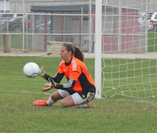 Paige Coolman makes a save for the Huntington North High School girls' varsity soccer team in a game against visiting Muncie Central on Saturday, Sept. 22. Coolman recorded nine saves to give the Lady Vikings a 1-0 shutout victory.