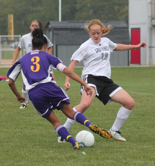 Lady Viking soccer player Hannah Williams defends against Marion's Victoria Smith in action at Huntington North on Tuesday, Sept. 25.