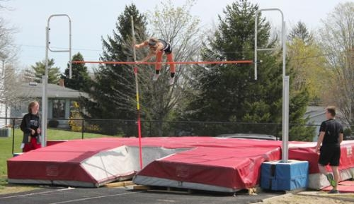 Huntington North senior Alxis Wygant clears the bar in the pole vault competition on Saturday, April 27, at the Lime City Relays at Kriegbaum Field. Wygant wound up second in the event.
