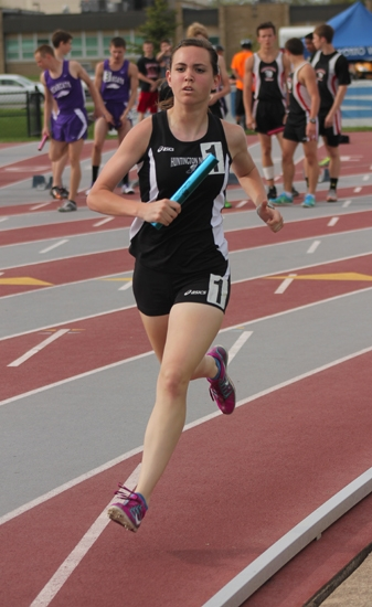 Kayla Patrick carries the baton for one leg of Huntington North's record-setting 3,200-meter relay team on Friday, April 3, at the North Central Conference Track & Field Championships.