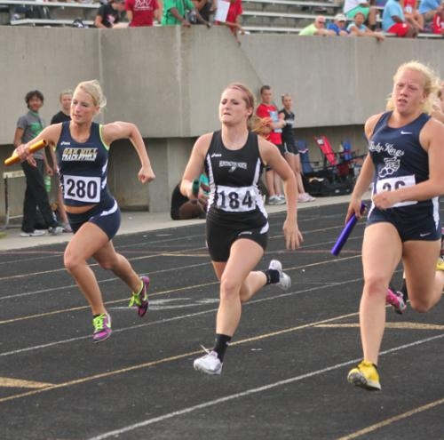Huntington North's Jamie Feller (center) runs the curve during the 400-meter relay at the Fort Wayne Northrop Girls' Grack Regional on Tuesday, May 21.