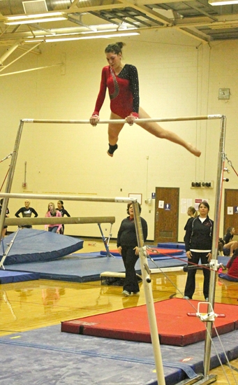 Huntington North senior Robyn Karst performs on the uneven parallel bars on Saturday, March 2, at the Muncie Central Gymnastics Sectional. Karst placed sixth on the event to help the Lady Vikings advance to regional.