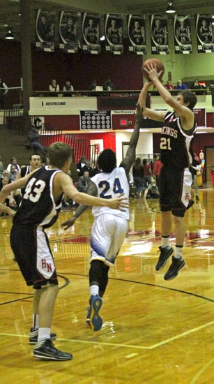 Viking forward Caleb Landrum launches a jumper in the Huntington North Basketball Sectional opener against Homestead on Tuesday, March 4. The Vikings lost 59-47.