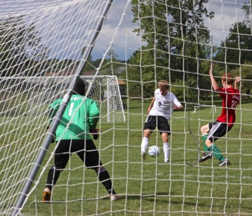 Huntington North's Isaac Wust (center) shoots the ball toward the visiting Anderson goal in soccer action on Saturday, Sept. 8. Wust didn't score on this shot, but he wound up with three goals in a 7-2 HNHS win.