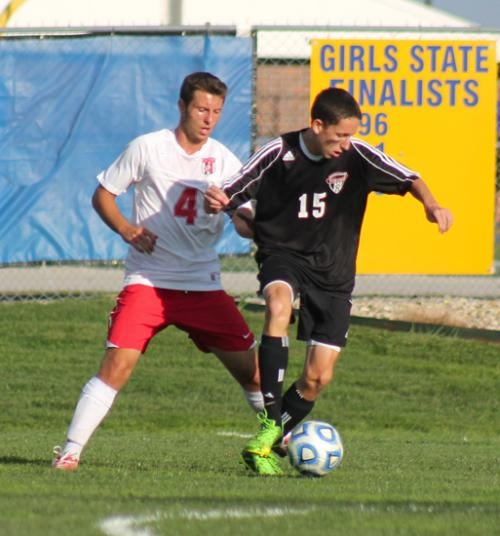 Huntington North midfielder Alex Hosler maneuvers with the ball against a Fort Wayne North Side defender in action Monday afternoon, Oct. 7, at the Homestead Soccer Sectional. The Vikings lost, 1-0.