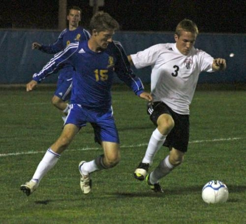 Huntington North player Barik Hiple (right) battles with Homestead's Seth Higginbotham for possession of the ball during the team's Homestead Sectional Tournament game on Monday, Oct. 1. The Vikings lost 3-2.