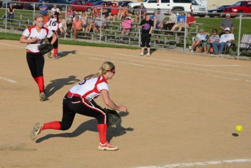 Huntington North third basemen Audrey Hiner (right) charges a grounder while pitcher Mikayla Gray watches during the Lady Vikings' 19-3 win over Marion on Wednesday, May 1.