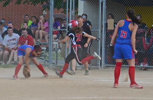 Huntington North's Natasha Grover (center) digs down the line just a step too late in sectional opener action against Jay County on Tuesday, May 21. The Lady Vikings won 5-1.