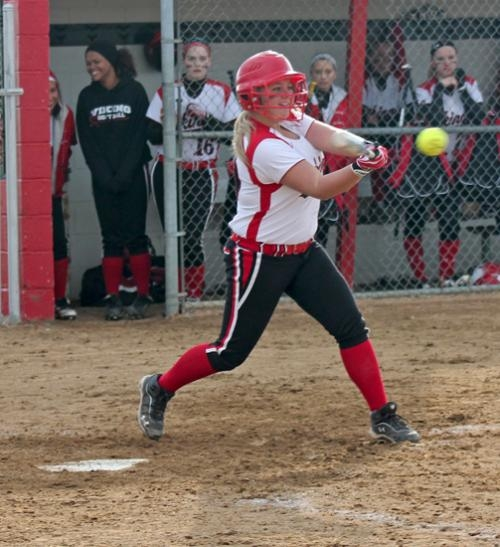 Huntington North's Tori Newsome cracks a smile before making contact with the ball during the varsity softball team's game against visiting DeKalb on Thursday, April 25. The Lady Vikings won 7-0.