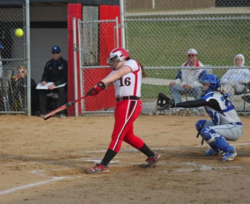 Huntington North's Kaylynn Rosen connects with the ball but flies out in the bottom of the first inning in the Lady Vikings' season-opening 8-1 loss to visiting Carroll on Thursday, April 10.