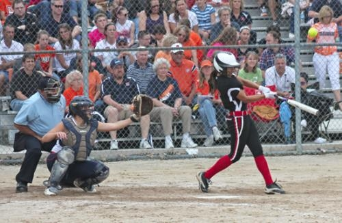 Huntington North's Maddi Kennedy fouls one off against Harrison in the Harrison Semi-State Softball semifinal game on Saturday afternoon, June 1.