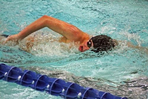 Huntington North sophomore Zane Cozad churns through the water in the 500-yard freestyle at the Warsaw Boys' Swim Sectional preliminaries on Thursday night, Feb. 20. His fifth place finish earned him a spot in the finals on Saturday morning.