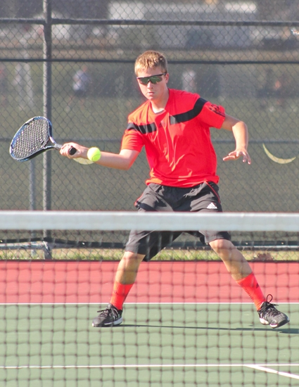 Huntington North's Cameron Buzzard gets ready to make a shot in his third singles match against Kyler Boots of Norwell on Tuesday, Sept. 4. Buzzard won his match.