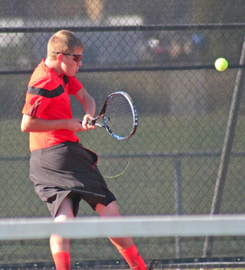 Huntington North's No. 3 singles player, Cameron Buzzard, twists and fires a backhand return during his match against Collin Moord of Fort Wayne Snider on Tuesday, Sept. 24. Buzzard won but the Vikings as a team lost.