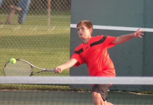 Nick May, part of the Huntington North second doubles team, returns a shot during sectional action against Belmont on Wednesday, Oct. 2.