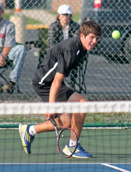 Huntington North Hgih School first singles player Aaron Gilmore watches his shot cross the net during Norwell Sectional Tournament play against Adams Central on Friday, Sept. 28.