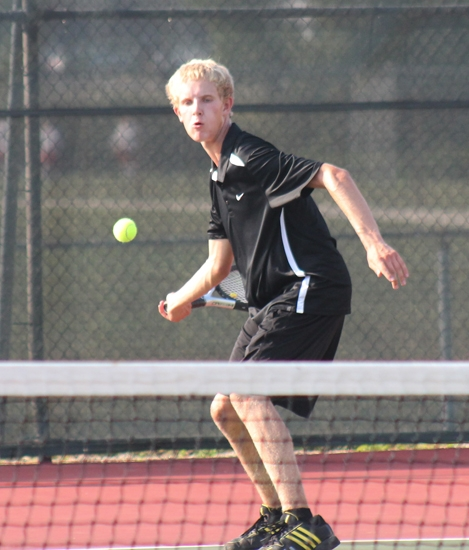 Huntington North's No. 1 singles player, Tommy Bolinger, gets set to whack a forehand in the Vikings' match against Columbia City on Thursday, Aug. 29.