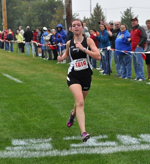 Kayla Patrick, a member of the Huntington North High School girls' varsity cross country team, crosses the finish line and snags first place overall at the North Central Conference meet at Indiana Wesleyan University, in Marion, on Tuesday, Oct. 2.