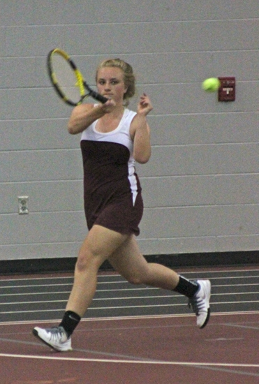 Emily Karst, a sophomore on the Huntington North girls' varsity tennis team, darts to return a shot in action at No. 1 doubles against visiting Richmond on Friday, May 9.
