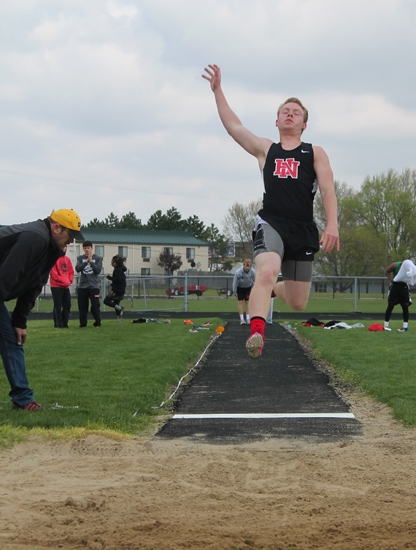 Huntington North's Aremis Ebert soars through the air while competing in long jump at the Lime City Relays, hosted by the Vikings on Saturday, May 3.