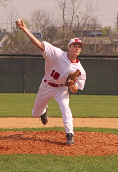 Huntington North pitcher Pat Miller sends the ball homeward in action against visiting Wabash on Saturday, April 15. Miller and his Viking mates took an 11-4 win.