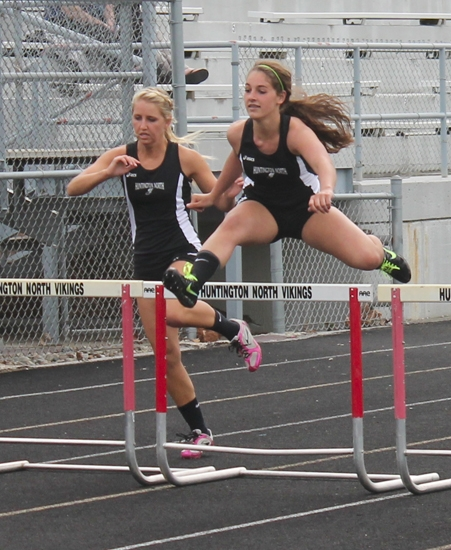 Lady Vikings Alexa Shoemaker (left) and Allie Christian compete in the 100-meter hurdles on Tuesday, April 29, in a meet with visiting Kokomo. Christian won in :17.00, with Shoemaker second.