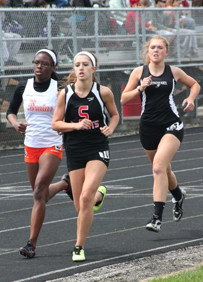 Stephanie McElhaney (third from left), a junior on the Huntington North High School girls' varsity track and field team, competes in the 1,600-meter run at the Lime City Relays, hosted by the Lady Vikings on Saturday, May 3.
