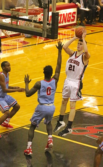 Mitchell Geller (right), a junior on the Huntington North High School boys' varsity basketball team, attempts a jumper in the lane in front of Wayne defender Craig Young during a game on Saturday, Feb. 11, at North Arena. The Vikings defeated the Generals, 60-44.
