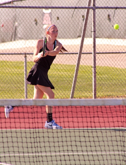 Huntington North's No. 1 singles player Jessica Henline smacks a backhand on her way to defeating Virginia Lagos of visiting South Adams in a match on Friday, May 12. The Lady Vikes won, 3-2.