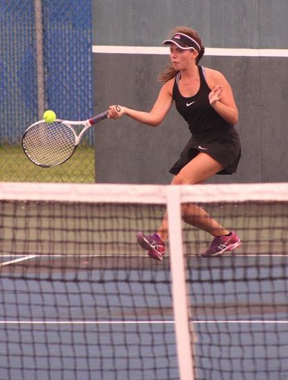 Senior Katie Hunt returns a shot at No. 2 singles during the Lady Vikes' sectional match against host Norwell  on Thursday evening, May 18. Hunt and the Lady Vikings fell, 1-4.