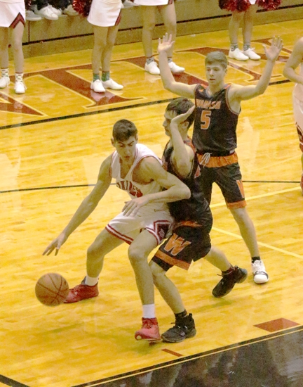 Huntington North forward Sawyer Stoltz works down low against a pair of Wabash defenders in the Vikings' 56-44 win over the Apaches on Friday, Dec. 22, at North Arena.
