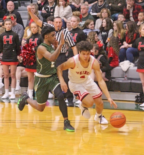 Huntington North guard Deven Newcomb draws a foul from his South Side defender while heading to the hoop in action Saturday night at Huntington's University's Platt Arena. The Vikings lost in overtime, 61-56.