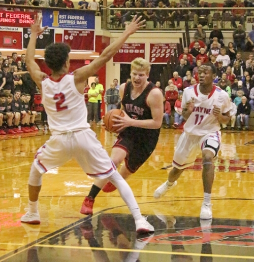 Huntington North guard Joe Stoffel charges into the lane against a pair of Fort Wayne Wayne defenders on Friday night, March 2, in the HNHS Sectional semifinal. The Vikes won on a buzzer-beater to advance to the championship game Saturday night, March 3, against Homestead.