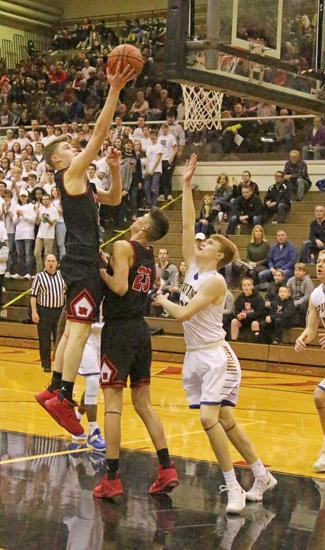 Viking forward Mitch Geller heads to the rack in the Huntington North Boys' Basketball Sectional championship game against Homestead on Saturday night, March 3. The Vikings' season ended with a 40-39 loss.