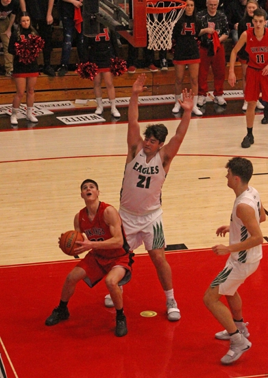 Huntington North's Zach Daugherty tries to look past the defense of Zionsville's Brandon Vernon near the basket in action at the Logansport Boys' Basketball Regional Tournament on Saturday, March 9. The Vikings lost, 52-41, to end a 22-5 season.