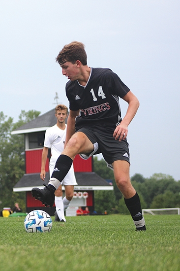 Taking control of the ball is Huntington North soccer player Ashton Hosler. The Vikings faced off against the Columbia City Eagles on Tuesday, Sept. 1, coming away with a hard-fought win in overtime. Hosler made one of Huntington North's three goals for the evening.