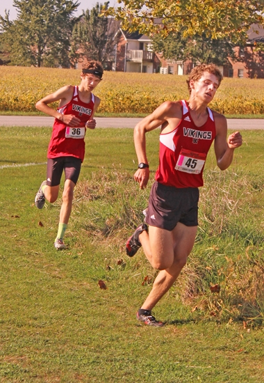 Nolan Young (right) and Drew Davis, members of the Huntington North High School boys' cross country team, compete at the Marion Sectional, held Saturday, Oct. 7, on the Indiana Wesleyan University Course. The Vikings placed all seven of their runners in the top 14 to win the sectional title in dominant fashion.