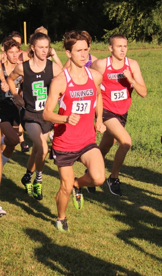 Huntington North runners JT York (left) and Connor Miller compete at the Huntington North Cross Country Invitational on Saturday, Aug. 24, at the Huntington University Cross Country Course.