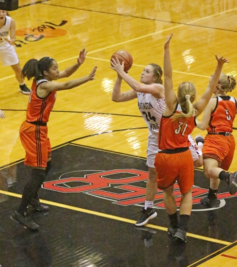 Rileigh Johnson (second from left), a senior on the Huntington North High School girls' varsity basketball team, attempts to get a shot off as defenders from visiting Warsaw converge on her position during the Lady Vikings' home opener on Friday, Nov. 10. Huntington North lost, 55-48.