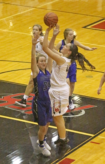 Huntington North High School center Maddy Robrock goes up with a short shot against Northfield on Saturday night, Nov. 18. Robrock scored 13 points in the Lady Vikes' 50-44 win.